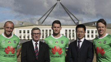 Josh Hodgson, Huawei Australia chair John Lord, Jarrod Croker, Huawei Australia CEO Hudson Liu and Sam Williams on the front lawn of Parliament House in Canberra.