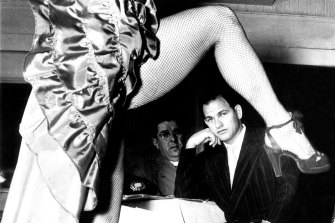 Abe Saffron watches a dancer at his Roosevelt Nightclub in Sydney in January 1951.