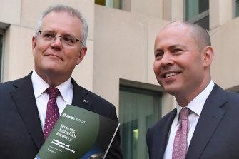 Prime Minister Scott Morrison and Treasurer Josh Frydenberg at Parliament House after unveiling the 2021-22 federal budget.