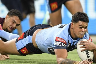 NRL player Latrell Mitchell reported online abuse he has received.