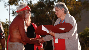 Mutitjulu elder Rolley Mintuma and Pat Anderson from the Referendum Council with a piti holding the Uluru Statement from the Heart during a ceremony at the First Nations National Convention in May 2017.