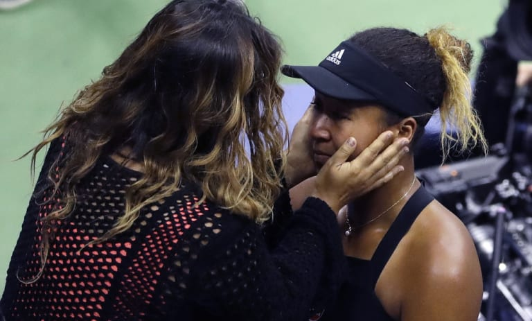 Naomi Osaka is hugged by her mom, Tamaki Osaka, after defeating Serena Williams in a controversial US Open final.