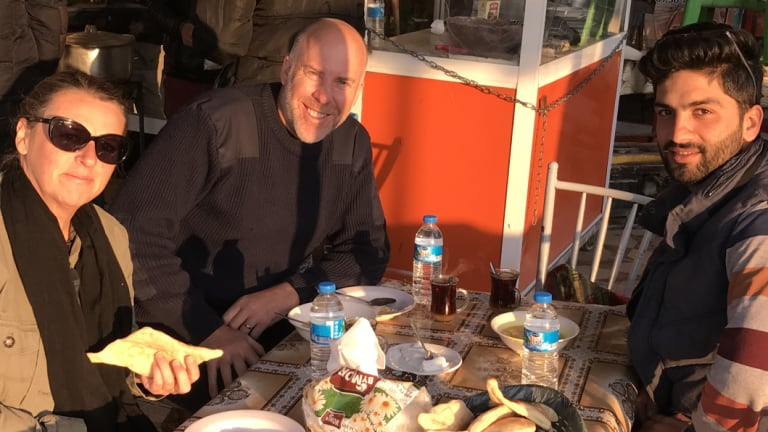 Kate Geraghty, Michael Bachelard and Halan Shekha having breakfast in what is locally known as Fish town in Northern Iraq in July 2017.