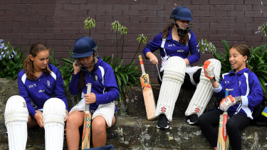 Marrickville Hudson under 15 girls cricket team players Siobhan O'Donnell 13 (left), Kira Hodgson-Yu 13 (2nd from left), Grace Keating 13 (2nd from right) and April Humphrys 12 (right) put on cricket helmets and lads before doing some catching drills at Petersham Oval.