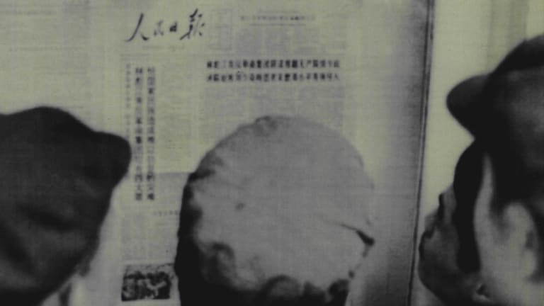 Beijing residents read the front page of the People's Daily reporting on the indictment of the Gang of Four in 1980.