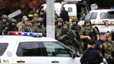 Police secure the area after a man opened fire at a synagogue in Pittsburgh.