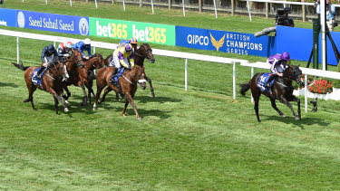 Impressive: US Navy Flag (right) wins the Darley July Cup Stakes at Newmarket.