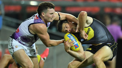 Tigers shake off dogged Dockers
