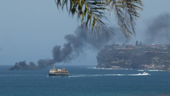 Four men escape overboard as fire engulfs vessel on Sydney Harbour