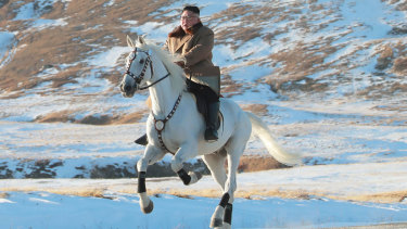 The North Korean government released this photo of Kim Jong-un riding a white horse to climb Mount Paektu.