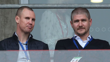 Newcastle Jets coach Carl Robinson, right, with Kenny Miller in the stands watching the Jets last weekend.