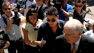 Drama: Hayne arrives at Kings Cross police station with his lawyer in Sydney in 2008. Hayne and fellow players Junior Paulo and Weller Hauraki gave statements about a shooting attack.