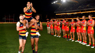 Carried away: Eddie Betts is shouldered off the field through a line of honour.