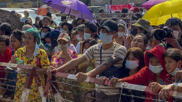 People gather outside Insein prison in Yangon expecting to see prisoners being released on Friday.