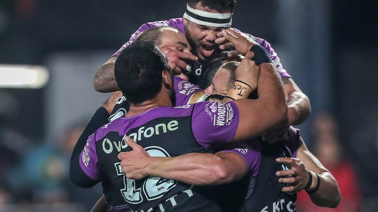 Group hug: Blake Green is mobbed by teammates after his second-half try sealed the win for the Warriors.