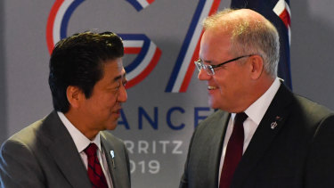 Japan's Prime Minister Shinzo Abe meets with Scott Morrison during the G7 Summit.