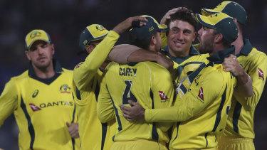 Australia celebrates the dismissal of India's captain Virat Kohli during the final ODI in India.