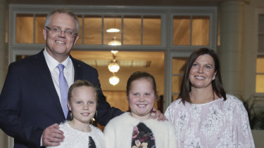Prime Minister Scott Morrison with his wife Jenny and daughters Abigail and Lily pose for photos after being sworn-in at Government House in Canberra on Friday.