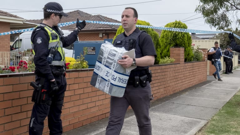 Forensic police remove evidence from the Campbellfield home.