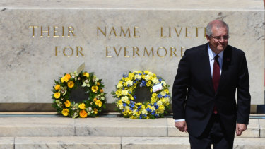 Prime Minister Scott Morrison lays a wreath during Remembrance Day at the Australian War Memorial.