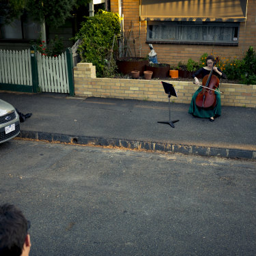 "Taking it to the streets … chamber musician Josephine Vains plays a social distancing ""concert"" for her neighbourhood in Melbourne's Brunswick."