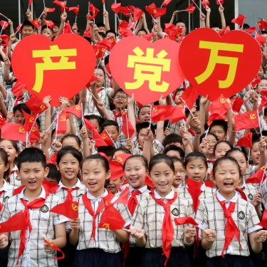 Students celebrate the 100th anniversary of the Party in Shandong Province, China in June.