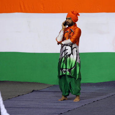 A supporter takes time out during a rally for Rahul Gandhi in New Delhi in March.