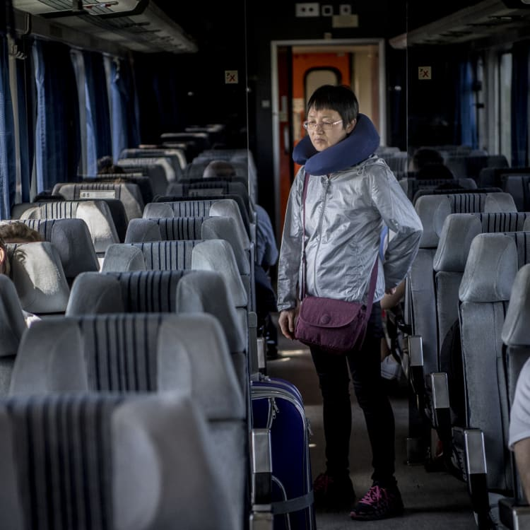 A passenger stretches her legs on the long trip from Serbia to Hungary.