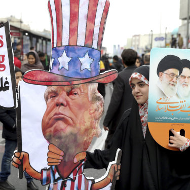An Iranian woman holds an effigy of US President Donald Trump during a rally.
