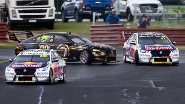Anton de Pasquale (#99) and Shane van Gisbergen (#97) collide during Saturday's 60km sprint race at Sandown.