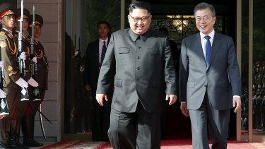 North Korea's Kim and South Korea's Moon at Saturday's surprise meeting.