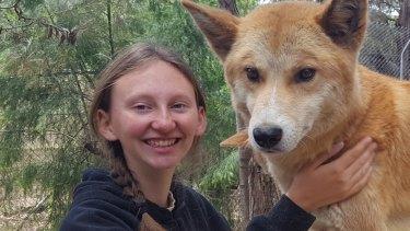 Chloe Gardner with dingo 'Mungka' at the Bargo Dingo Sanctuary.