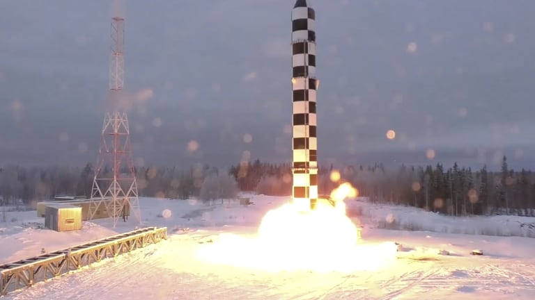 Russia's new Sarmat intercontinental ballistic missile blasts off during a test launch from an undisclosed location in Russia.