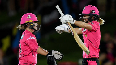 Good night: Ellyse Perry, right, and Dane Van Niekerk embrace after Perry hit a boundary to win and bring up her century.