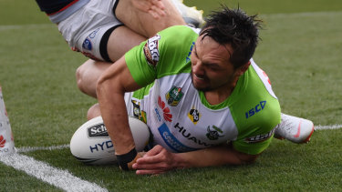 Jordan Rapana of the Raiders scores a try during the Round 23 NRL match between the Canberra Raiders and the Sydney Roosters at GIO Stadium in Canberra.