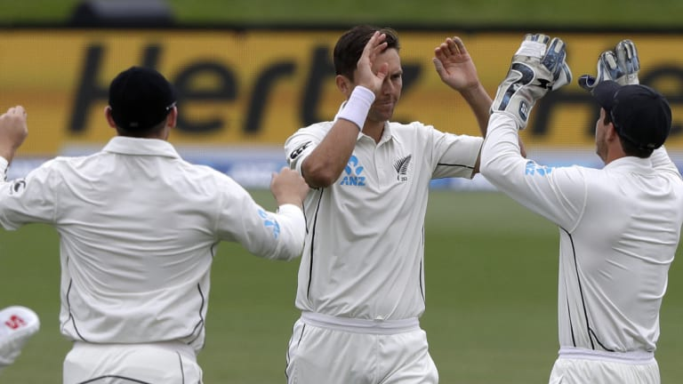 Quick-fire: Trent Boult (centre) is congratulated by teammates after quickly securing New Zealand's victory on day five.
