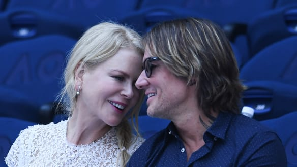 Nicole Kidman and Keith Urban watching the women's singles semifinal match on day eleven of the Australian Open tennis tournament in Melbourne on Thursday.