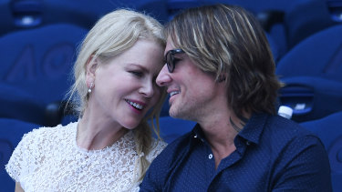 Nicole Kidman and Keith Urban watching the women's singles semi-final match on day 11 of the Australian Open in Melbourne on Thursday.