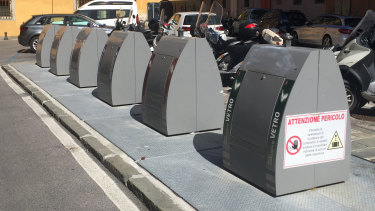 Italy's six bins system in use near the Tower of Pisa. They sit atop subterranean skip bins allowing for a greater volume of waste.