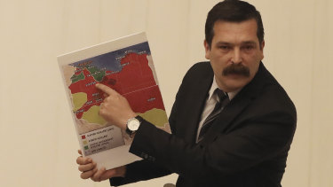 Erkan Bas, an opposition MP of the Workers' Party, shows a map of divided Libya before Turkey's parliament authorised the deployment of troops to Libya.