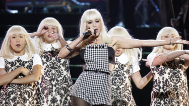 Gwen Stefani, with her Harajuku Girls, at the Billboard Music Awards in 2006.