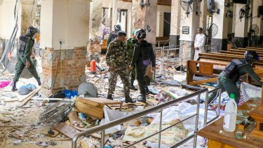 Security forces inspect the carnage after an explosion hit St Anthony's church in Kochchikade in Colombo, Sri Lanka.
