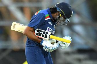 Jhulan Goswami celebrates after hitting the winning runs against Australia.