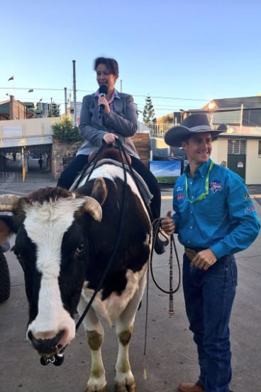 ABC Brisbane breakfast co-hostRebecca Levingston atopBullseye the Bull.