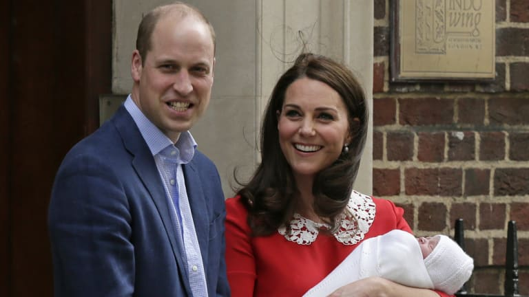 Prince William and Kate, Duchess of Cambridge smile as they hold their newborn baby son as they leave the Lindo wing at St Mary's Hospital in London on Monday, April 23.