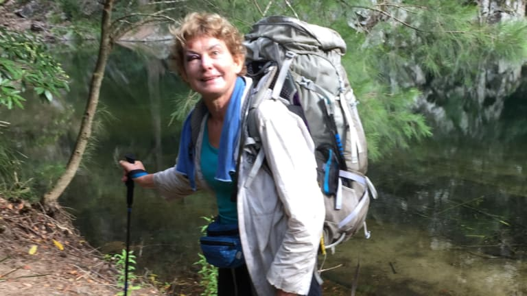 Francisca Boterhoven De Haan, with a black eye after slipping on a rock, in front of a creek during her hike in Morton National Park.