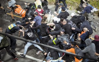 Anti-authority protesters clash with Victoria police at an anti-lockdown rally in Richmond.