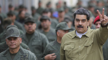 Venezuelan leader Nicolas Maduro, right, has stepped up his appearances with the military.