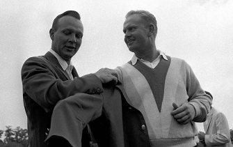 Green machine: Arnold Palmer (left) helps Jack Nicklaus into another green jacket after Nicklaus' nine-stroke victory at the Masters in 1965.