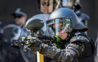 The specially equipped riot police have lightweight armour, helmets, riot shields and a range of weapons.